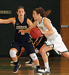 SPEARFISH, SD - JANUARY 8, 2016 -- Julia Seamans #3 of Black Hills State drives on Jessica Ramos #5 of Regis during their college basketball game Friday at the Donald E. Young Center in Spearfish, S.D. (Photo by Dick Carlson/Inertia)