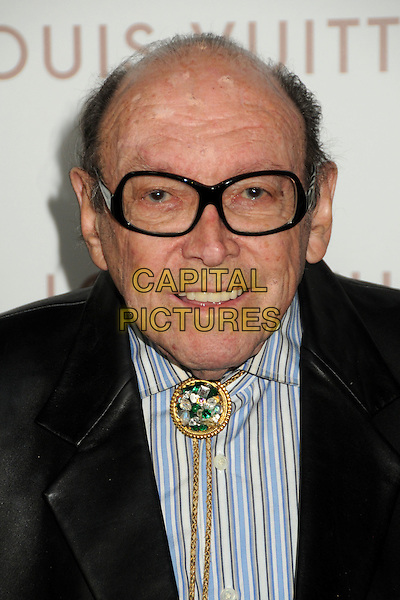 "MARVIN PAIGE .""Somewhere"" Los Angeles Premiere held at Arclight Cinemas, Hollywood, California, USA, .7th December 2010..portrait headshot glasses blue striped brooch gold black .CAP/ADM/BP.©Byron Purvis/AdMedia/Capital Pictures."