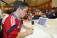Diego Fernandez Becerra Ramirez consults his tablet computer which is displaying an origami crease pattern