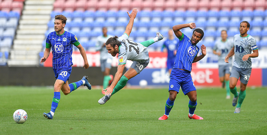 Blackburn Rovers' Ben Brereton is fouled by  Wigan Athletic's Nathan Byrne<br /> <br /> Photographer Dave Howarth/CameraSport<br /> <br /> The EFL Sky Bet Championship - Wigan Athletic v Blackburn Rovers - Saturday 27th June 2020 - DW Stadium - Wigan<br /> <br /> World Copyright © 2020 CameraSport. All rights reserved. 43 Linden Ave. Countesthorpe. Leicester. England. LE8 5PG - Tel: +44 (0) 116 277 4147 - admin@camerasport.com - www.camerasport.com