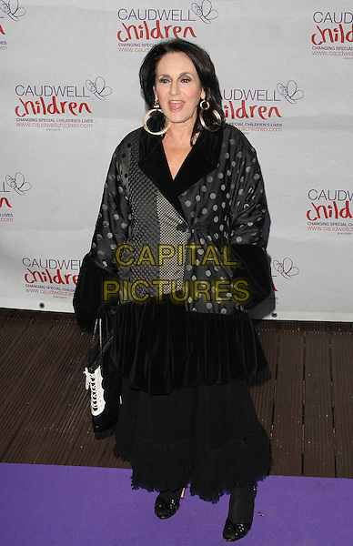 Lesley Joseph.Caudwell Childrens' Butterfly Ball at the Battersea Evolution, London, England. September 15th 2011.full length dress black grey gray polka dot print mouth open.CAP/JIL.©Jill Mayhew/Capital Pictures