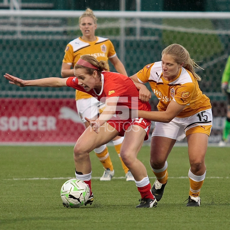 Beverly Goebel (19) of the Western New York Flash, left and Colleen Flanagan of the Atlanta Beat battle for the ball during the first half of their WPS match at Sahlen's Stadium in Rochester, NY May 01, 2011. New York 3, Atlanta 0.