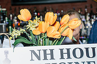A bouquet of flowers stands next to Texas senator and Republican presidential candidate Ted Cruz as he speaks to a crowd at a business round-table at the Draft Sports Bar and Grille in Concord, New Hampshire.
