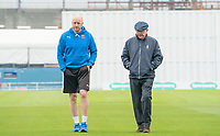 Picture by Allan McKenzie/SWpix.com - 13/04/2018 - Cricket - Specsavers County Championship - Yorkshire County Cricket Club v Essex County Cricket Club - Emerald Headingley Stadium, Leeds, England - Yorkshire coach Andrew Gale and umpire Ian Gould leave the field afte play on the first day of the County Championship was abandoned at Headingley.