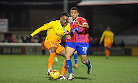 Gozie Ugwu of Wycombe Wanderers turns Joe Widdowson of Dagenham & redbridge during the Sky Bet League 2 match between Dagenham and Redbridge and Wycombe Wanderers at the London Borough of Barking and Dagenham Stadium, London, England on 9 February 2016. Photo by Andy Rowland.