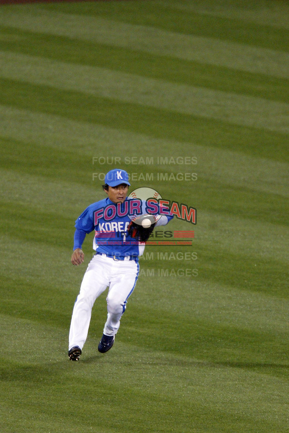 Jong-Beom Lee of Korea during the World Baseball Championships at Angel Stadium in Anaheim,California on March 15, 2006. Photo by Larry Goren/Four Seam Images