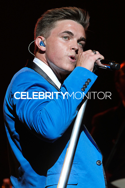 UNIVERSAL CITY, CA - SEPTEMBER 04: Singer Jesse McCartney performs at the Gibson Amphitheatre on September 4, 2013 in Universal City, California.  (Photo by Xavier Collin/Celebrity Monitor)