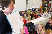 NWA Democrat-Gazette/CHARLIE KAIJO Dr. Virginia Abernathy, assistant superintendent for teaching and learning, reads to 3rd graders, Friday, March 2, 2018 at Bellview Elementary School in Rogers.<br /><br />Bellview Elementary School celebrated Read Across America with some special guest readers