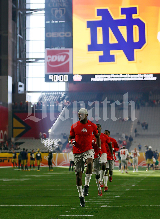 Ohio State Buckeyes safety Tyvis Powell (23) warms up prior to the Battlefrog Fiesta Bowl against the Notre Dame Fighting Irish at University of Phoenix Stadium in Glendale, Arizona on Jan. 1, 2016. (Adam Cairns / The Columbus Dispatch)