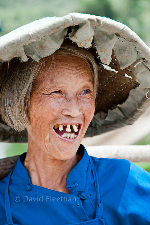 An old woman smiles with crooked teeth in the countryside village of Yiling, Nanning, Guangxi, China. NMR