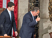 Outgoing Speaker of the United States House of Representatives John Boehner (Republican of Ohio), right, acknowledges the cheers of his colleagues as he leaves the podium for the last time as Speaker as incoming Speaker of the US House of Representatives Paul Ryan (Republican of Wisconsin), left, looks on in the US House Chamber in the US Capitol in Washington, DC on Thursday, October 29, 2015.<br /> Credit: Ron Sachs / CNP