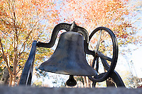Bell Island bell with fall leaves<br />  (photo by Megan Bean / &copy; Mississippi State University)