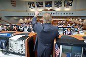 NASA Launch Director Michael Leinbach congratulates the launch team in the NASA Kennedy Space Center Firing Room Four of the Launch Control Center (LCC) shortly after the space shuttle Atlantis, STS-135, launched on Friday, July 8, 2011, in Cape Canaveral, Florida. The launch of Atlantis, STS-135, is the final flight of the shuttle program, a 12-day mission to the International Space Station. .Mandatory Credit: Bill Ingalls / NASA via CNP
