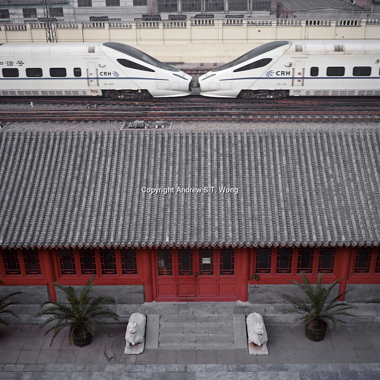 A Chinese high speed train passes a traditional building at the remnants of the Beijing city wall, October 2011. (Mamiya 6, 75mm f3.5, Kodak Ektar 100 film)