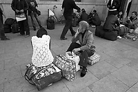 Daytime landscape view of two women waiting at the B?ij?ng Zhàn in D?ngchéng Q? in Beijing.  © LAN