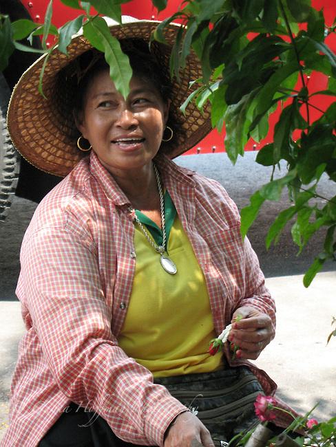 Thai lady flower seller.