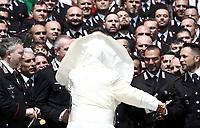 Un soffio di vento solleva la mantellina di Papa Francesco mentre saluta alcuni Carabinieri durante l'udienza generale del mercoledi' in Piazza San Pietro, Citta' del Vaticano, 30 maggio, 2018.<br /> A gust of wind blows the Pope's mantel as he greets a group of Carabinieri during weekly general audience in St. Peter's Square, at the Vatican, on May 30, 2018. <br /> UPDATE IMAGES PRESS/IsabellaBonotto<br /> <br /> STRICTLY ONLY FOR EDITORIAL USE