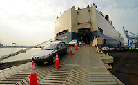 Hyundai vehicles roll off  a ship docked  at the Philadelphia Regional Port Authority's Packer Marine Terminal Tuesday, August 10, 2010. Philadelphia's port won a five year contract as the eastern port of entry for Hyundia vehicles, with over 1500 cars arriving with each ship's delivery.  (Bradley C Bower/Bloomberg News)