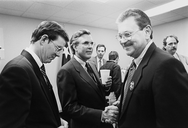Representative Joe Barton, Richard Fisher and Jose Angel Gutierrez after Friday night debate at South Texas College of Law. April 15, 1993 (Photo by Maureen Keating/CQ Roll Call)