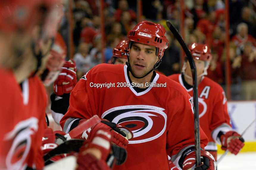 Carolina Hurricane's Niclas Wallin is congratulated by his bench after an Erik Cole (not pictured) goal against the Boston Bruins during an NHL hockey game Saturday, Dec. 2, 2006 in Raleigh, N.C. Carolina won 5-2.<br />