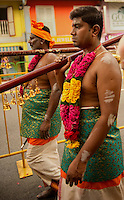 The Thaipusam Hindu festival is celebrated in worship of Lord Murugan through offerings of pain and self sacrifice. Traditionally a male representing his whole family carries milk pots attached to his body by hooks along a long walk to the temple.   The carrier may fast and meditate for days to prepare for this ritual, and is accompanied along the way by friends and family. The kavadi can weigh up to 20 kilograms and are decorated with peacock feathers and images of Hindu deities. He may also wear spiked sandals. 02/07/2012