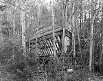 This unfinished trawler was swallowed up by a young forest when the South River boatbuilder in coastal Carteret County in N.C. was unable to complete the vessel.  It's a rather large trawler, about 60 feet long.