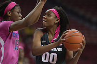 NWA Democrat-Gazette/J.T. WAMPLER Arkansas' Jessica Jackson eyes the basket while Kentucky's Evelyn Akhator defends during the second half Thursday Feb. 16, 2017 at Bud Walton Arena in Fayetteville. The Wildcats won 69-62.