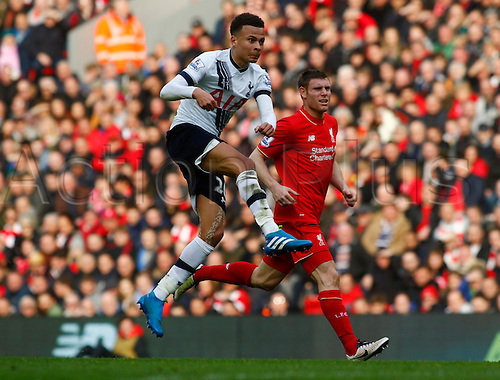 02.04.2016. Anfield, Liverpool, England. Barclays Premier League. Liverpool versus Tottenham Hotspur.  Spurs midfielder Dele Alli shoots from the edge of the area as James  Milner watches on.