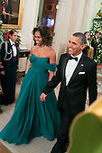 United States President Barack Obama and First Lady Michelle Obama arrive for a reception at the White House for the 2013 Kennedy Center Honorees on December 8, 2013 in Washington, DC. The honorees this year include: opera singer Martina Arroyo, jazz musician Herbie Hancock, musician Billy Joel, actress Shirley MacLaine and musician Carlos Santana. <br /> Credit: Kristoffer Tripplaar  / Pool via CNP