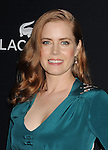 BEVERLY HILLS, CA- FEBRUARY 22: Actress Amy Adams arrives at the 16th Costume Designers Guild Awards at The Beverly Hilton Hotel on February 22, 2014 in Beverly Hills, California.