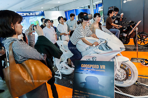 A visitor tries a virtual reality simulator ''GODSPEED VR'' at the 1st Advance Content Technology Expo in Tokyo Big Sight on July 1, 2015. Content Tokyo 2015 is Japan's largest international contents business event composed of 6 exhibitions including the Advanced Content Technology Expo and is held until July 3rd.(Photo by Rodrigo Reyes Marin/AFLO)
