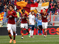Calcio, Serie A: Roma-Genoa. Roma, stadio Olimpico, 12 gennaio 2014.<br /> AS Roma forward Francesco Totti, right, celebrates with teammates after scoring during the Italian Serie A football match between AS Roma and Genoa, at Rome's Olympic stadium, 12 January 2014. <br /> UPDATE IMAGES PRESS/Isabella Bonotto