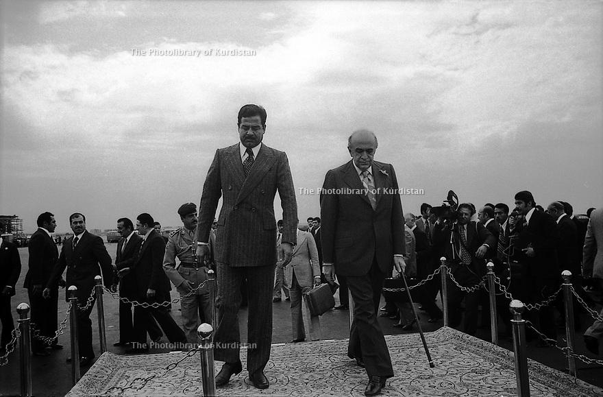 Iran 1975<br /> Amir Abbas Hoveida, a droite, accueille a l'aéroport de Teheran Saddam Hussein, vice-président irakien apres les accords d'Alger<br /> Iran 1975<br /> Amir Abbas Hoveida, prime minister of Iran, welcomes at Tehran Airport Saddam Hussein, vice-president of Iraq after the Algiers agreements