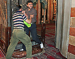 """A Bodyguard (L) scuffles with a Palestinian man during the visit of Middle East envoy Tony Blair to the Ibrahimi mosque at the site of teh Tomb of the Patriarchs in the West Bank town of Hebron on October 20, 2009. Bodyguards subdued a Palestinian man as he approached Blair, shouting """"You are a terrorist."""" Photo by Najeh Hashlamoun"""