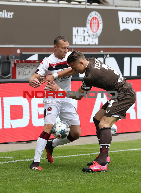 nph00001  17.05.2020 --- Fussball --- Saison 2019 2020 --- 2. Fussball - Bundesliga --- 26. Spieltag: FC Sankt Pauli - 1. FC Nürnberg ---  DFL regulations prohibit any use of photographs as image sequences and/or quasi-video - Only for editorial use ! --- <br /> <br /> Adam Zrelak (11, 1. FC Nürnberg ) Leo Östigard Oestigard (3, FC St. Pauli ) <br /> <br /> Foto: Daniel Marr/Zink/Pool//via Kokenge/nordphoto