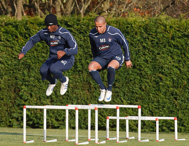 Maurice Edu and Madjid Bougherra are synchronised over the hurdles at training