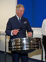 Prince Charles laughing as he tries to play the steel drum - London