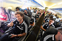 Wednesday 07 August 2013<br /> Pictured: Jose Canas (L) gives the thumbs up on the aeroplane en route to Malmo.<br /> Re: Swansea City FC travelling to Sweden for their Europa League 3rd Qualifying Round, Second Leg game against Malmo.