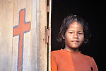 A girl in a doorway in the Cambodian village of Att Su.