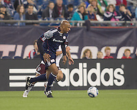 New England Revolution midfielder Ousmane Dabo (6) dribbles. In a Major League Soccer (MLS) match, the New England Revolution tied the Colorado Rapids, 0-0, at Gillette Stadium on May 7, 2011.