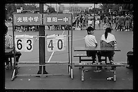 A makeshift scoreboard is used during matches of the China High School Basketball League in Zhuhai, Guangdong province, November 2011.