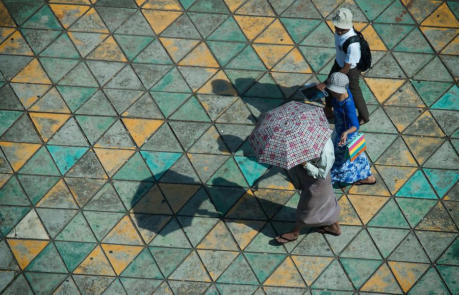 people on a side walk in Yangon, Myanmar