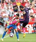 Sporting de Gijon's Nacho Cases (l) and FC Barcelona's Arda Turan during La Liga match. September 24,2016. (ALTERPHOTOS/Acero)