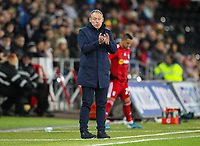 29th November 2019; Liberty Stadium, Swansea, Glamorgan, Wales; English Football League Championship, Swansea City versus Fulham; Steve Cooper manager of Swansea City applauds his team after a good phase of play - Strictly Editorial Use Only. No use with unauthorized audio, video, data, fixture lists, club/league logos or 'live' services. Online in-match use limited to 120 images, no video emulation. No use in betting, games or single club/league/player publications