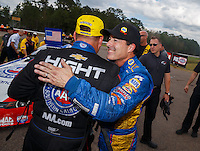 Mar 20, 2016; Gainesville, FL, USA; NHRA funny car driver Robert Hight (left) is congratulated by runner up Ron Capps as he celebrates after winning the Gatornationals at Auto Plus Raceway at Gainesville. Mandatory Credit: Mark J. Rebilas-USA TODAY Sports