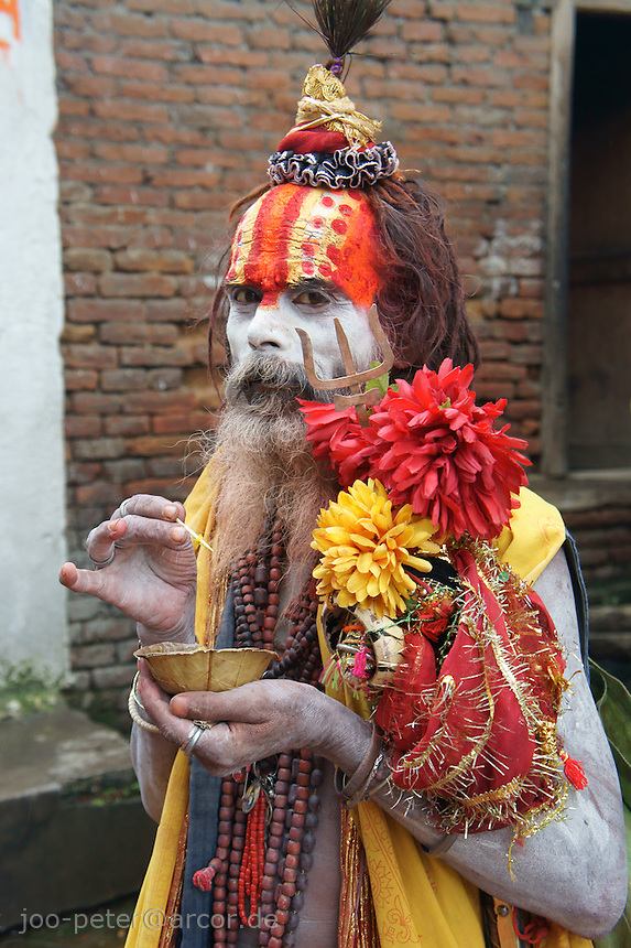 Pashupatinath, Kathmandu, Nepal, September 2011. Follower of Vishnu (next supreme god Shiva, who is mainly adored in Pashupatinath)