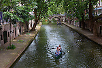 Canoeing on the Oudegracht canal, Utrecht, Netherlands
