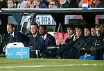 Nederland, Rotterdam, 12 oktober 2012.Kwalificatiewedstrijd WK 2014.Nederland-Andorra .De bank van Oranje met o.a. de assistent-trainers Danny Blind (l.) en Patrick Kluivert (3e van links) en Louis van Gaal, (2e van links) trainer-coach van Oranje.