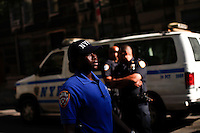 "A police officer pauses during a silent march to end the ""stop-and-frisk"" program in New York June 17, 2012.  Photo by Kena Betancur / VIEWpress.."