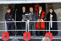 Pictured: Kevin Johns and local dignitaries lead the commemoration at Castle Square Gardens in Swansea, Wales, UK. Monday 11 November 2019<br /> Re: Armistice Day, a service to commemorate those who lost their lives in conflict has been held at Castle Square Gardens in Swansea, Wales, UK.